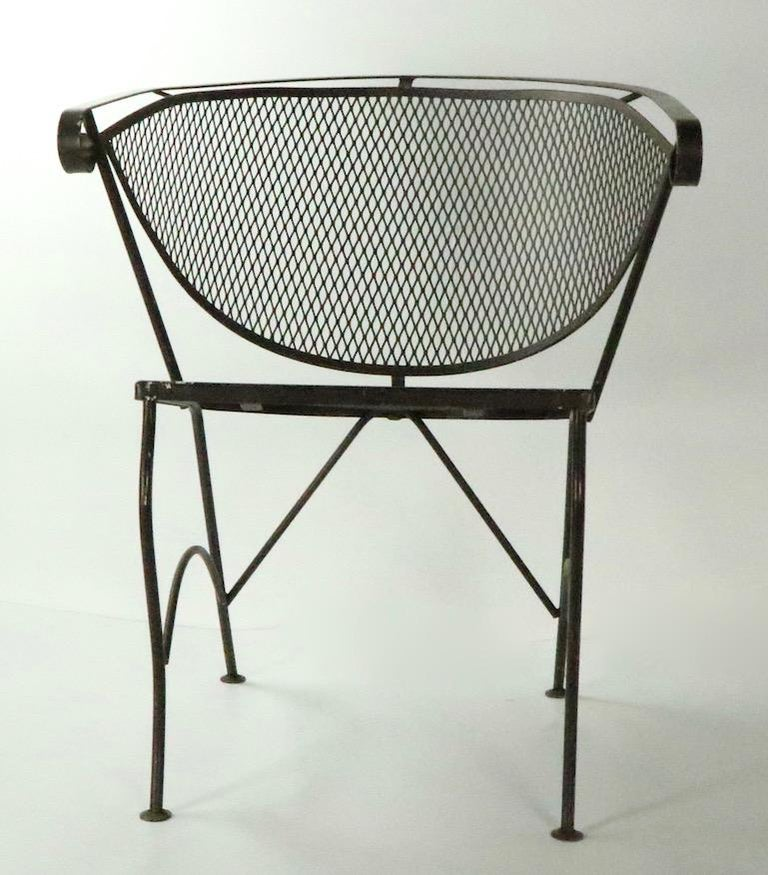 Set of 4 modernist outdoor chairs patio chairs, attributed to Woodard. These chairs are in very good condition, free of breaks, bends or repairs, currently in later brown paint finish. Usable as is, or we offer custom powder coating if you prefer a