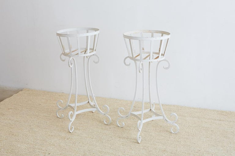 Matched set of four painted planters or plant stands made of wrought iron. Featuring 15