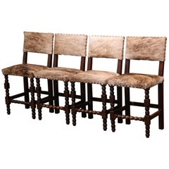 Set of Four 19th Century French Carved Oak, Leather and Cow Hide Bar Stools