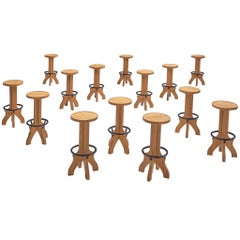 Set of Fourteen French Barstools in Elm