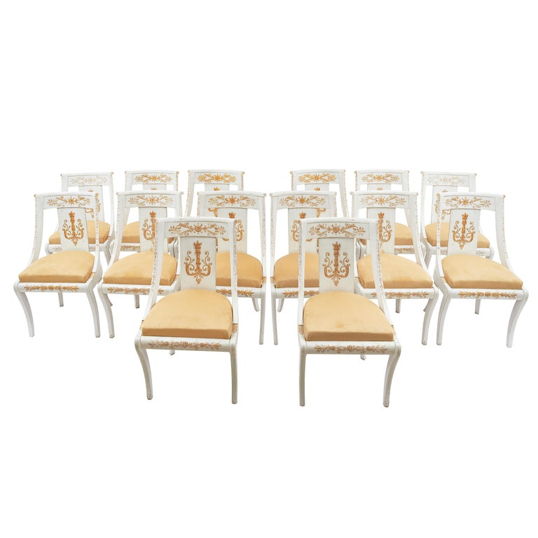 Set of Fourteen French Empire Painted Wooden Chairs, circa 1820 For Sale
