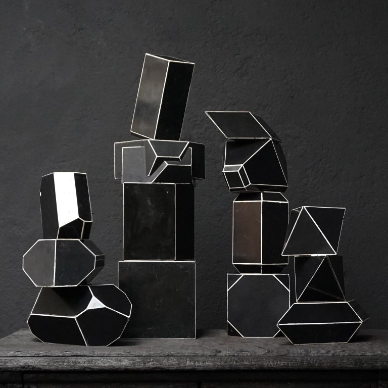 Set of fourteen early 20th century black Bakelite crystal models with white edges.  These crystal models used to be used as teaching material at school, to show students the difference in crystal shapes. Crystals are commonly recognised by their