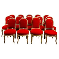 Set of Fourteen Orange Velvet Upholstered Dining Chairs, circa 1920s