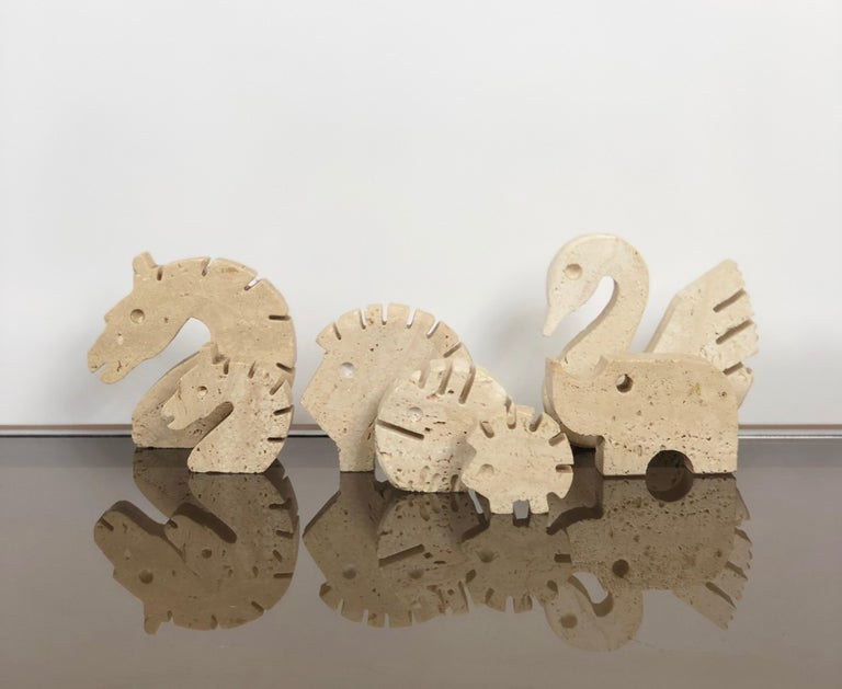 Seven travertine pieces by Fratelli Mannelli in Minimalist style. Beautiful desk accessories/letter holders. Various dimensions: the biggest is 9 x 9 x 2 cm - the smallest 5 x 4 x 2 cm.