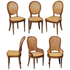 Set of French Caned Walnut Bergère Dining Chairs, Two Arms and Four Side Chairs