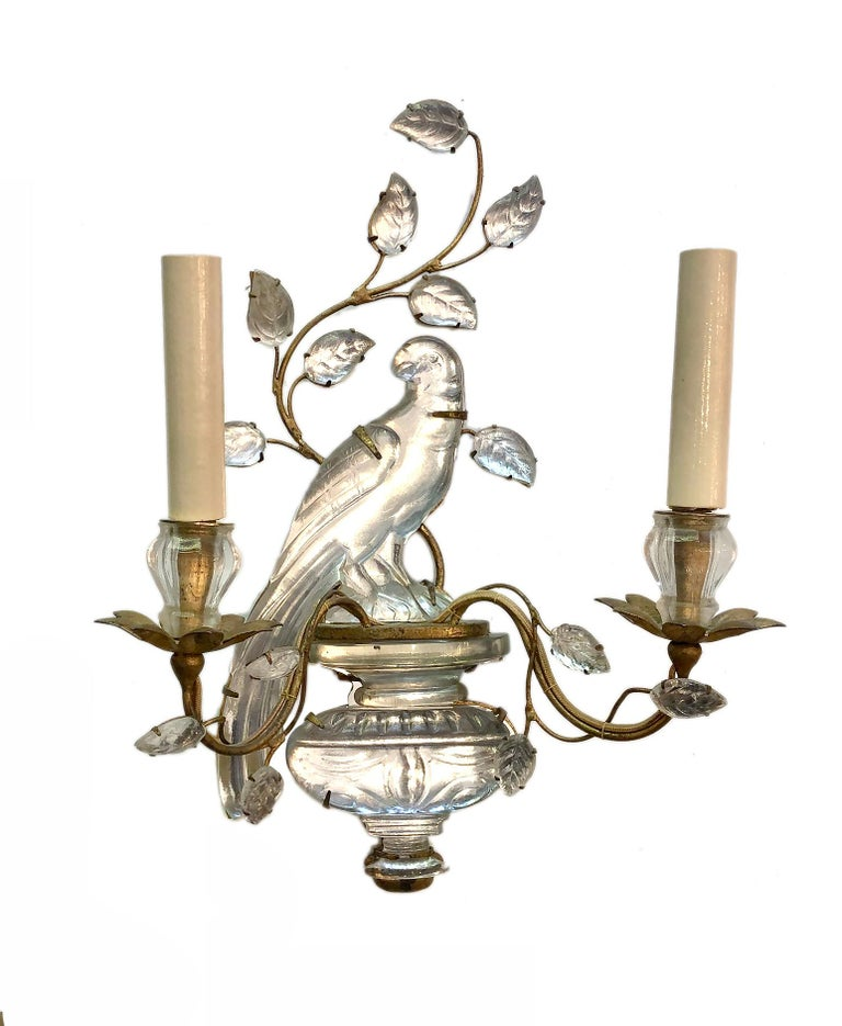 A set of four of circa 1950s French gilt metal two-arm sconces with molded glass parrot and leaves. Sold per pair.