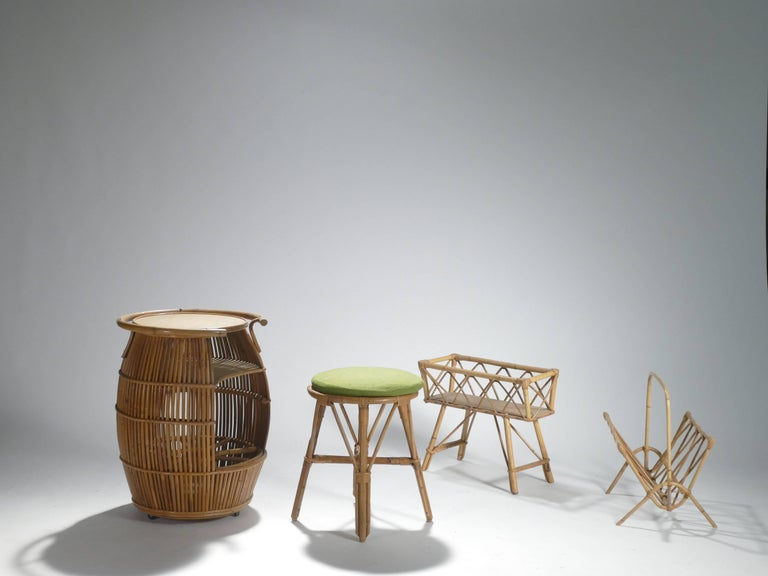 A beautiful set of bamboo-made garden decoration designed by Adrian Audoux and Frida Minet from the 1950s, including a stool, a high barrel table, a magazine rack and a planter, which are all remain in great condition/quality. The bamboo-vintage