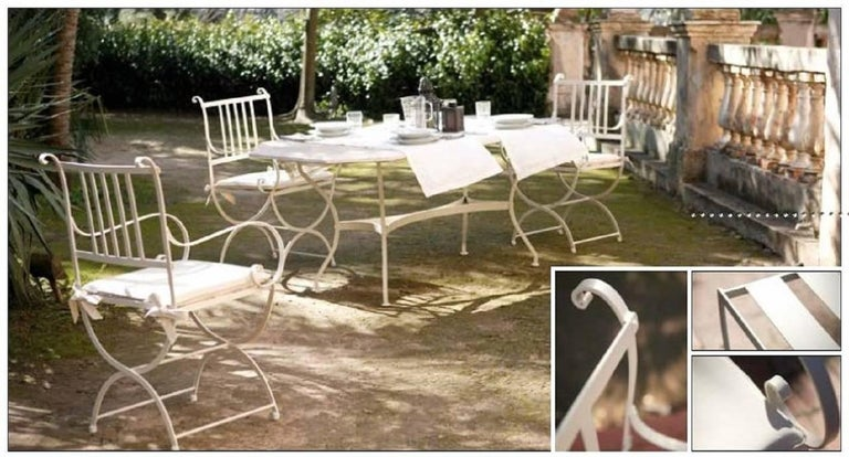 Set of garden furniture with four armchairs and glass top in forged iron Beautiful handmade set of patio or garden furniture. It´s made of forged iron with a special antioxidant painting . Cushions included  Armchairs measurements: H 37.4 in W