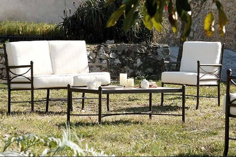 Set of garden furniture with two armchairs and one sofa in forged iron Beautiful handmade set of patio or garden furniture. It´s made of forged iron with a special antioxidant painting. Cushions included.  Armchairs measurements: H 35.43 in W