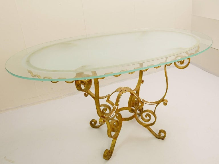 Set of gilded wrought iron dining table and 4 armchairs