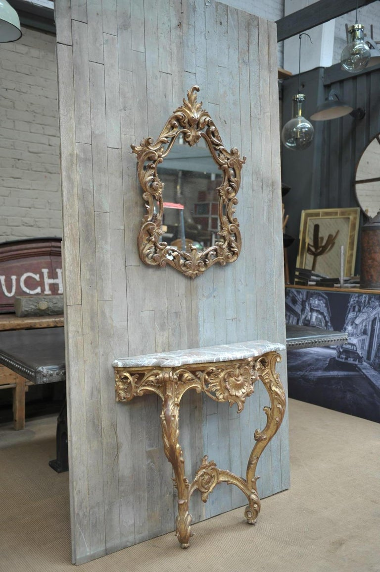 Set of console table and mirror Louis XV style in giltwood and marble top circa 1960. Console 84 x 33 x H 79.58 cm Miroir 61 x 6 x H 83 cm.