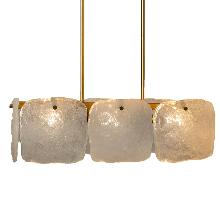 A stunning set of light fixtures designed by J.T Kalmar, manufactured by Kalmar Franken, Austria in the 1960s. High-end and handmade design from the 20th century. The large squares of white, opaque textured glass shades (each approximately 17cm x