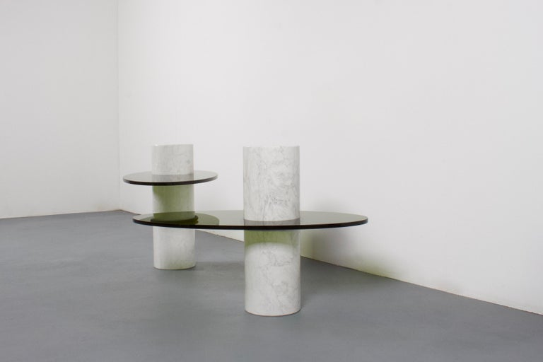 Set of Space Age tables in excellent condition.  These tables consist of a marble column which holds a Lucite top.  The heavy column is made of polished Carrara marble.  The oval top is made from a thick olive green Lucite.  The top is held into
