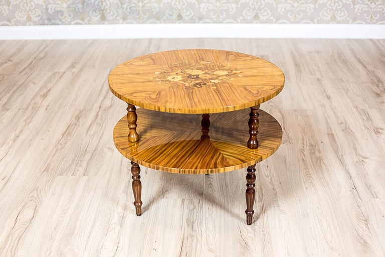We present you this creative coffee table composed of three segments. Each of them can be used as a separate piece of furniture. Set together, they form an oval table of a sort. Every segment is placed on turned legs, which are screwed in with a