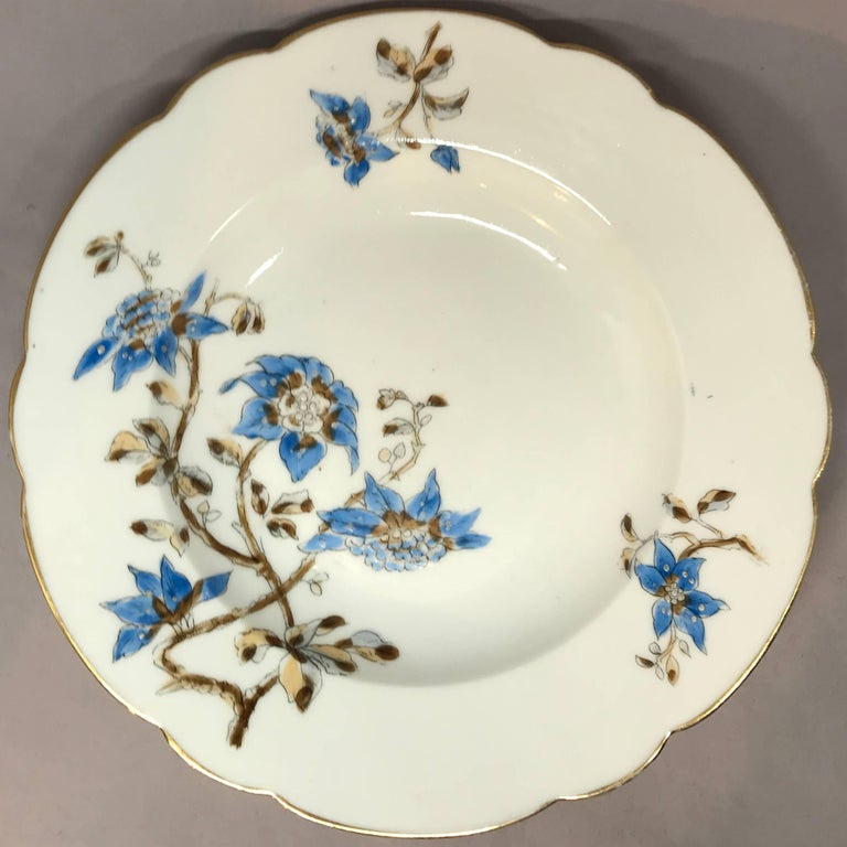 Set of five Italian blue and white floral plates. Five gilt-edged lobed soup plates with blue and brown floral decoration, Italy, circa 1890.  Dimensions: 9.88