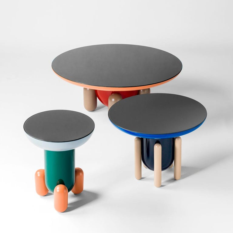 Multi-color-1 explorer tables  Design by Jaime Hayon, 2019 Manufactured by BD Barcelona.  Laquered fibreglass body. Solid turned wooden legs and lacquered. Painted glass tabletop.  Measures: 100 Ø x 42 cm 60 Ø x 46 cm 40 Ø x 50 cm  -