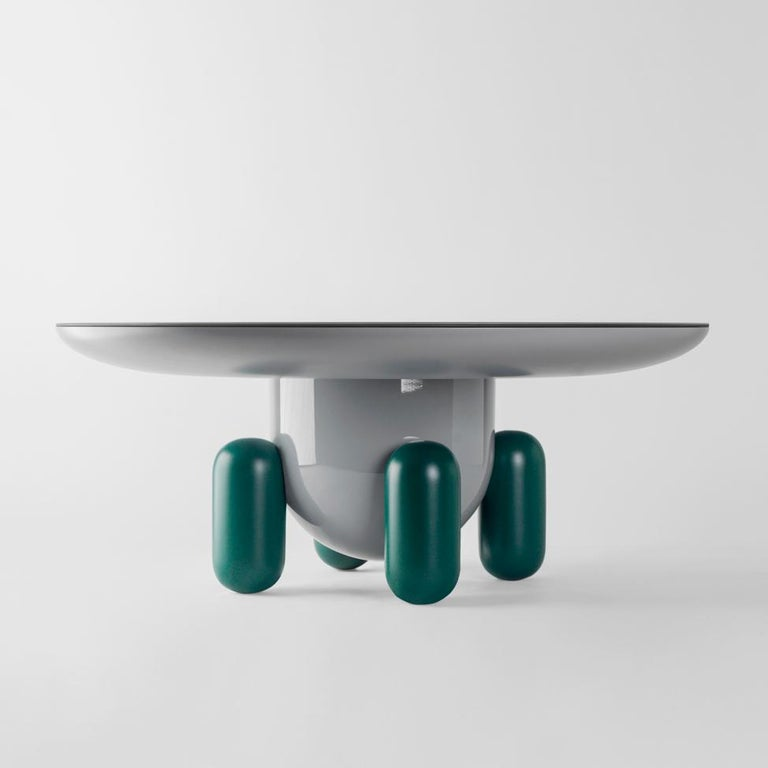 Multi-color-2 explorer tables  Design by Jaime Hayon, 2019 Manufactured by BD Barcelona.  Laquered fibreglass body. Solid turned wooden legs and lacquered. Painted glass tabletop.  Measures: 100 Ø x 42 cm 60 Ø x 46 cm 40 Ø x 50 cm  -