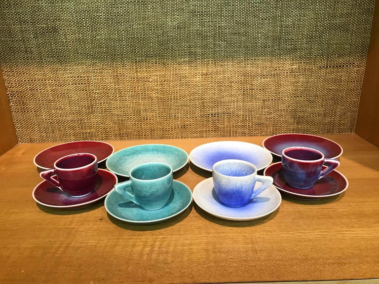 Unique set of four contemporary Japanese hand-glazed porcelain demitasse cups and saucers and four matching dessert plates, in a beautiful shape masterfully hand-glazed in the artist's stunning signature colors like wine-red, green and white, signed