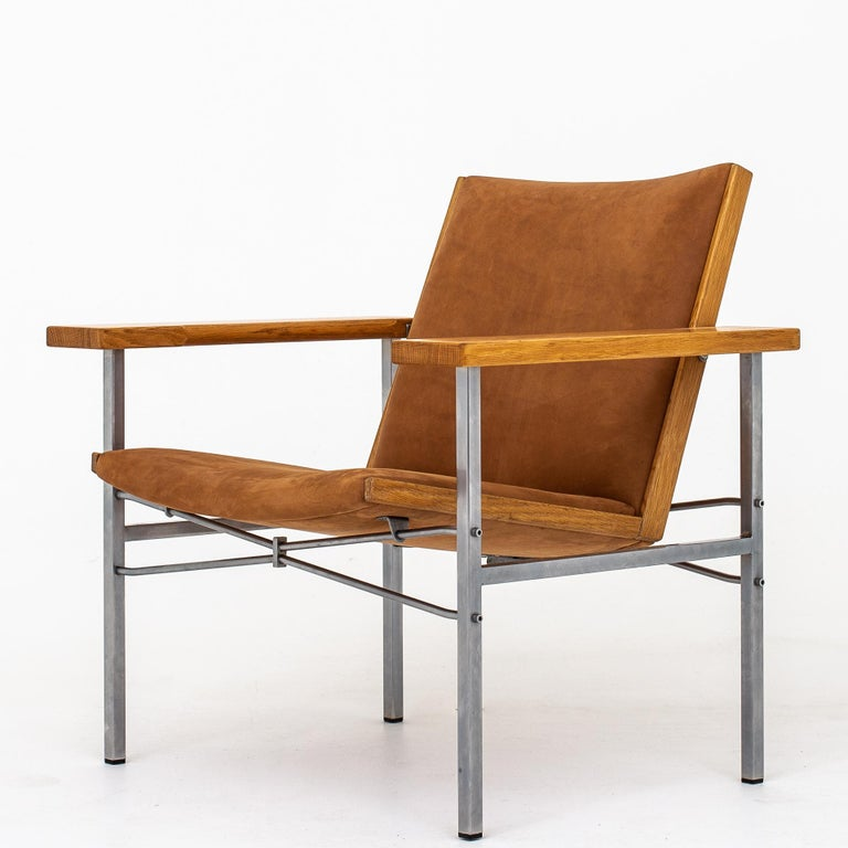JH 703 - Easy chairs in oak and steel, reupholstered with Dunes cognac leather. Maker Johannes Hansen.