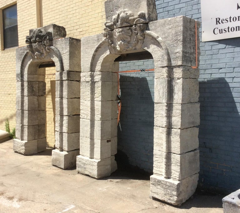 Antique limestone entryway arches, each with a decorative hand carved keystoned lintel.  Origin: France  circa 1800  Measurements: Approx. 8' W x 13' H (overall).