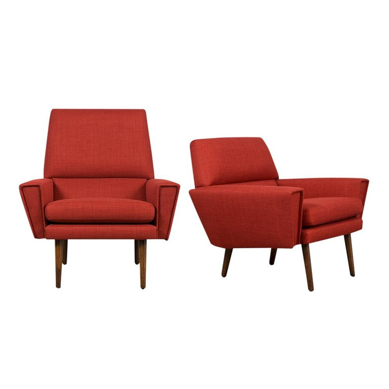 This Pair of Vintage Kurt Ostervig Danish Lounge Chairs have been completely restored and professionally upholstered in new red fabric. The chairs feature new comfortable removable cushions, seat, and back and armrests. The armchairs are resting on