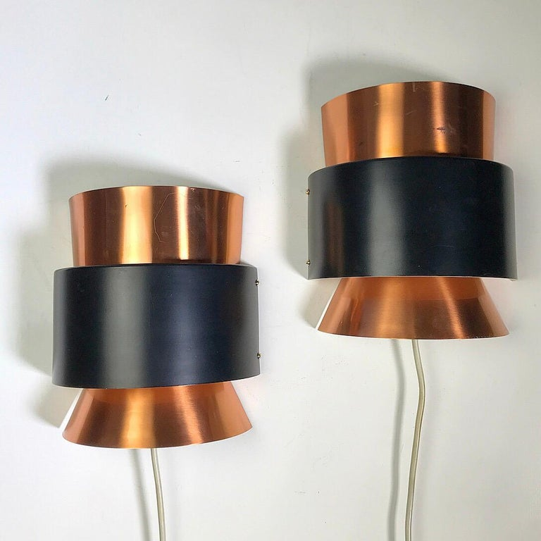 Sometimes you find something incredible extraordinary. This set of Danish copper wall sconces is indeed that. Made by Fog & Mørup, Denmark, 1960s.