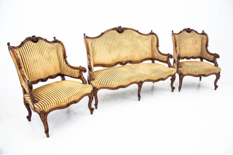Salon set, France, circa 1890. Very good condition. After renovation.  Origin: France - Paris Wood: Walnut  Dimensions sofa: Height 101, 5 cm, width 135 cm bersers: Height 96.5 cm width 70 cm.