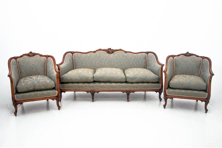 Set of Louis Philippe style salons, France, circa 1920.  Very good condition.  Wood: walnut  Dimensions:  Sofa height 88 cm, seat height 50 cm, length 190 cm 85 cm  Armchairs height 88 cm, seat height 50 cm 80 cm, width 76 cm.