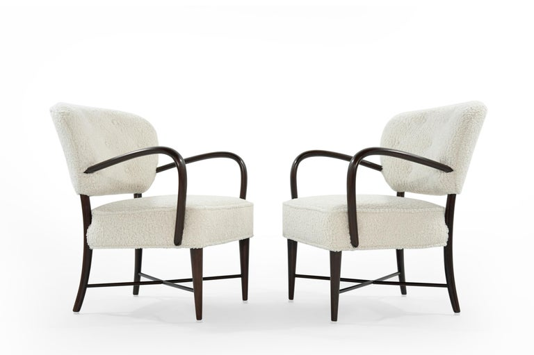 A handsome set of Italian open arm lounge chairs newly upholstered in bouclé by Kravet. Walnut frame fully restored.