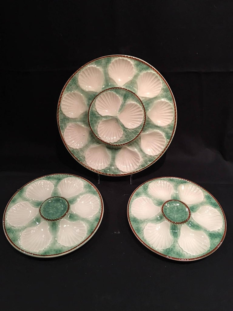 Set of Majolica long champ nine oyster plates and a platter, 19th century. Plates are 9.5