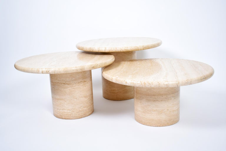 Set of three Mid-Century Modern travertine coffee tables, on round pedestal legs.  These round tables have different heights, allowing a free, creative and even overlapping disposition. True eye-catcher, the travertine has beautiful lines and is