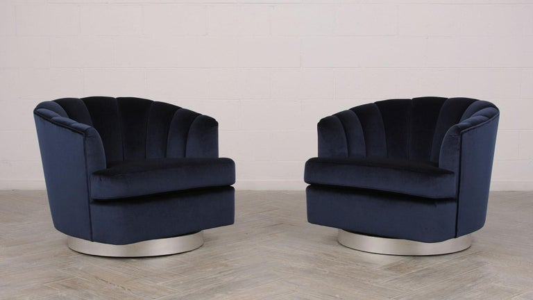 Beautiful pair of Modern Milo Baughman 1960s swivel chairs. Chairs have been professionally reupholstered in a dark blue velvet fabric with a single piping trim details. The back of the chairs have a Chanel's design that gives them an amazing look