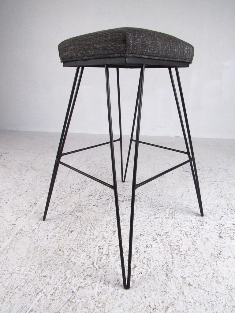 This matched set of three Mid-Century Modern hairpin barstools add retro charm and comfort to home or business bar seating. Stylish Frederick Weinberg style hairpin and upholstered padded seats make this 30.5 inch high set a striking addition to any