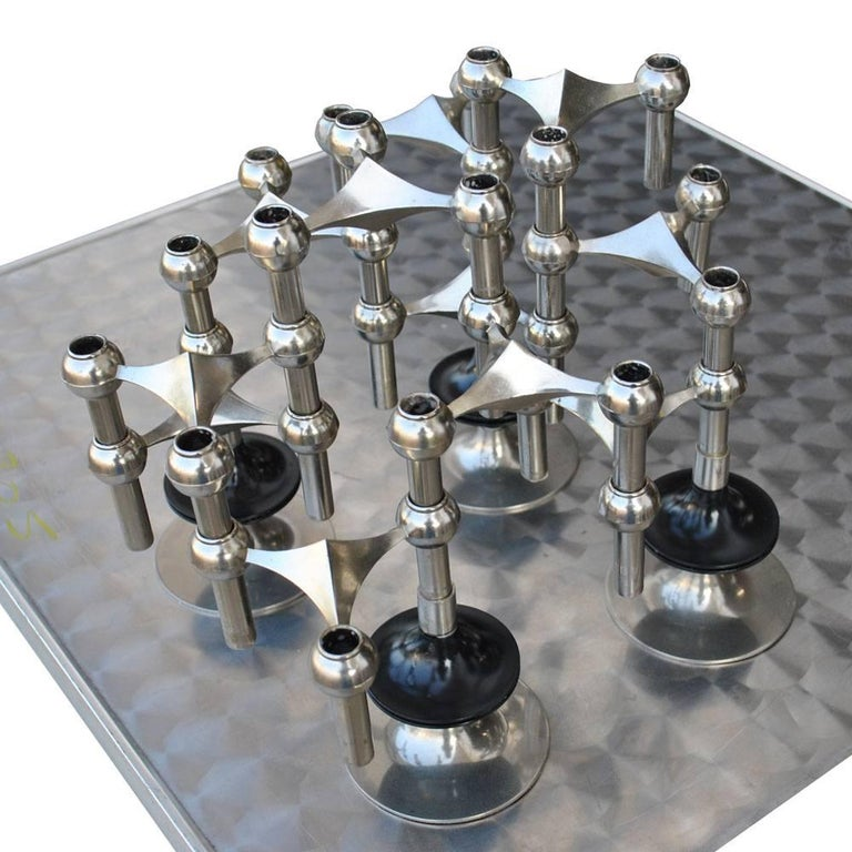 Bayerische Metallwaren Fabrik  Caesar Stoffi and Fritz Nagel  Set of 15 Nagel and Stoffi Modular chrome-plated candleholders Four bases, 11 candleholders Can be configured in endless patterns and configurations.  Measures: Each piece 4