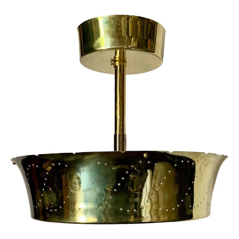 A set of four circa 1960's midcentury Swedish glass and gilt metal semi-flush light fixture. Sold individually.  Measurements: Drop 16