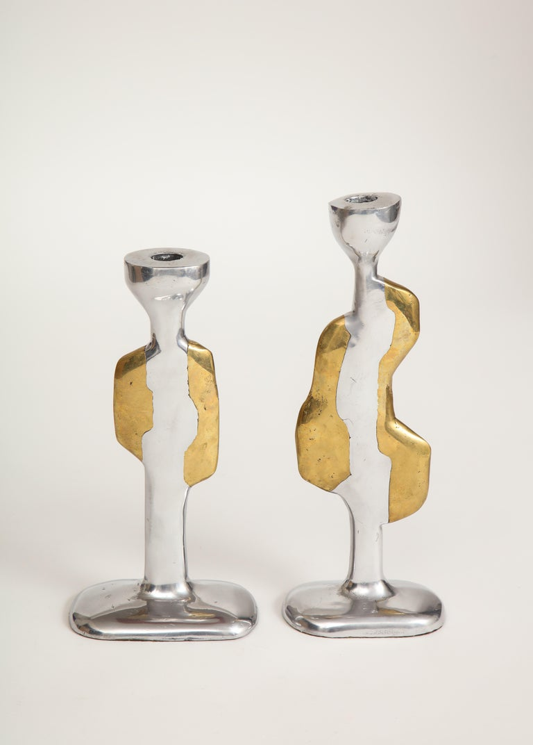 Nickel and brass. Sticks of two heights. Irregular anthropomorphic shapes.   Marked.