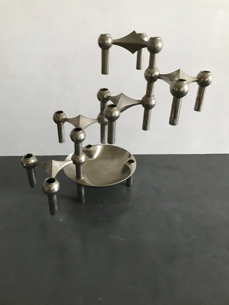 A Classic Nagel candleholder set, with a rare dish. The set holds 5 candle segments and a dish. It can be configured in various number of ways, as well vertically as horizontally by stacking the interlocking pieces.