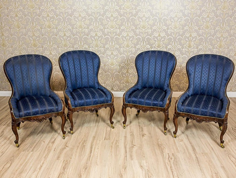 We present you four neat armchairs, so-called DOUILLETTE, made of rosewood and rosewood veneer.