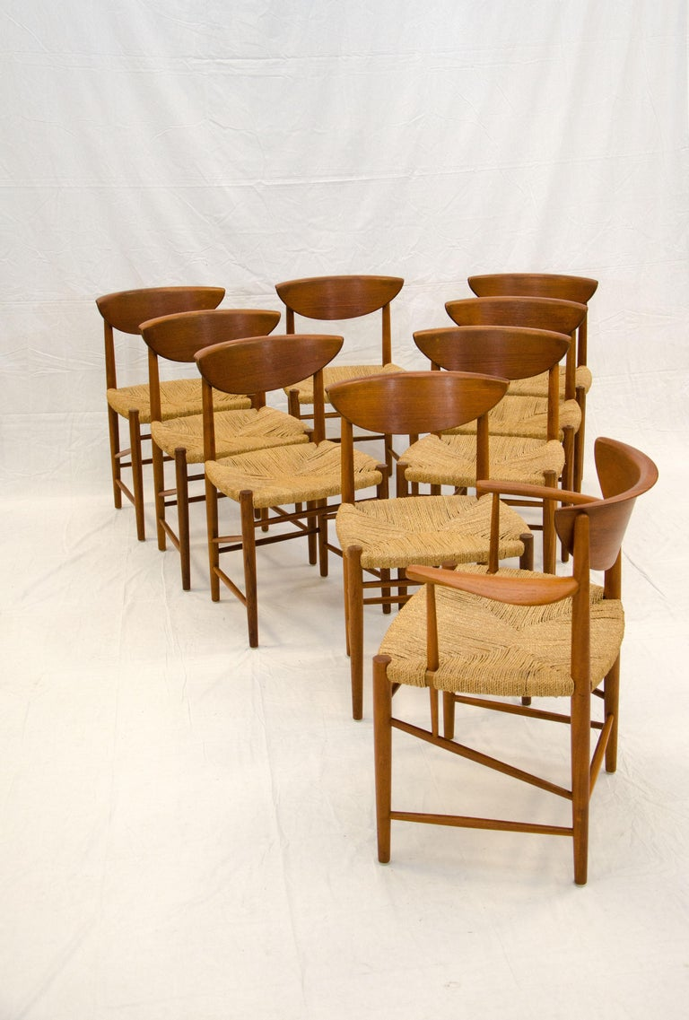 A beautiful set of Danish teak dining chairs by renowned designer Peter Hvidt manufactured by Soborg Mobler. A rare find in this excellent condition with original finish and original woven seagrass seats, without loose cords or staining. The arms