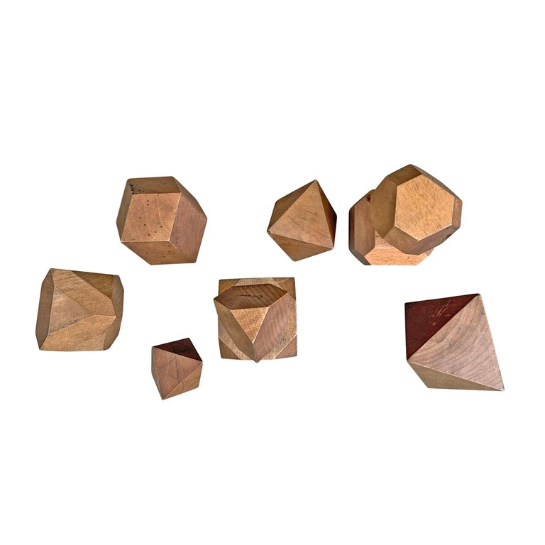 A wonderful set of nine German carved wood models originally used by students studying the crystal structures of minerals. Dimensions listed are for the largest piece.