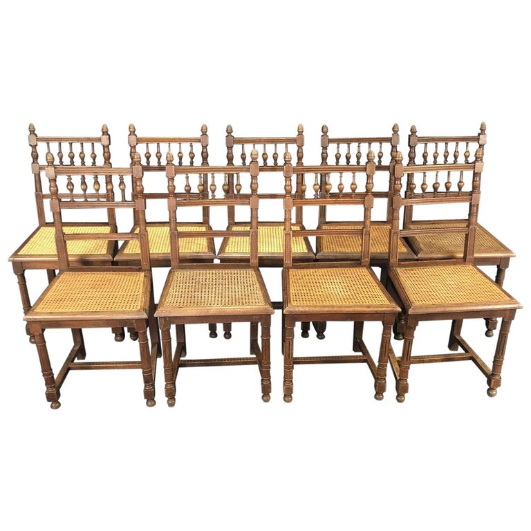 Set of Nine Period French Henri II Oak and Caned Dining Chairs For Sale