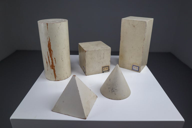Set of painted white patinated wooden geometric models/sculptures. Used for classroom study, Austria, circa 1950s.  Size from 3 to 6.2