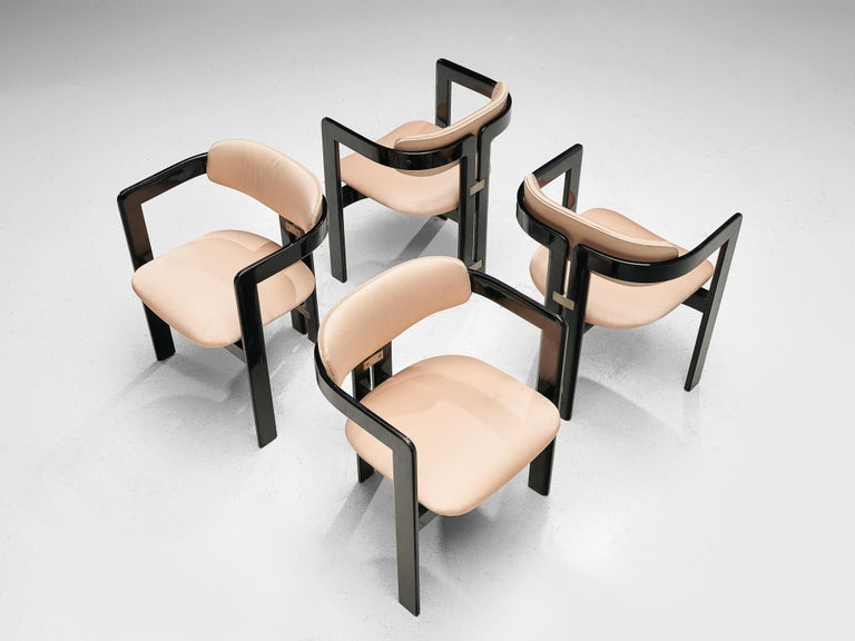 Augusto Savini, set of four 'Pamplona' dining room chairs, ebonized ashwood and soft pink leather, by for Pozzi, Italy, 1965.  Set of four armchairs in black lacquered ash and soft pink leather. A characteristic design; simplistic yet very strong in