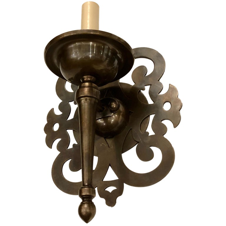 Set of Patinated Bronze Arabesque Sconces, Sold per Pair In Good Condition For Sale In New York, NY