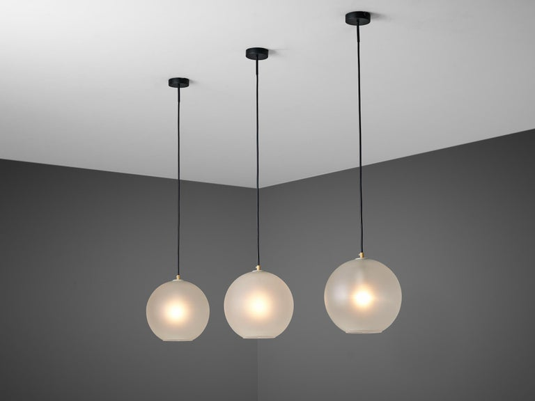 Set of ten pendants, in glass and metal, Europe 1970s.  Set of ten modern pendants with frosted glass globe shaped spheres. Available in every height admired.