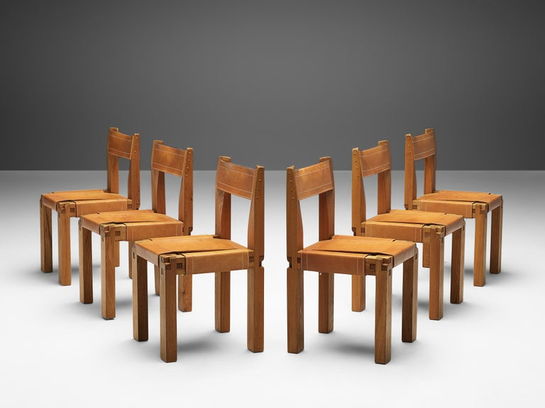 Pierre Chapo, set of six dining chairs, model S11, elm and leather, France, circa 1966.   A set of six chairs in solid elmwood with black saddle leather seating and back, designed by French designer Pierre Chapo. These chairs have a cubic design