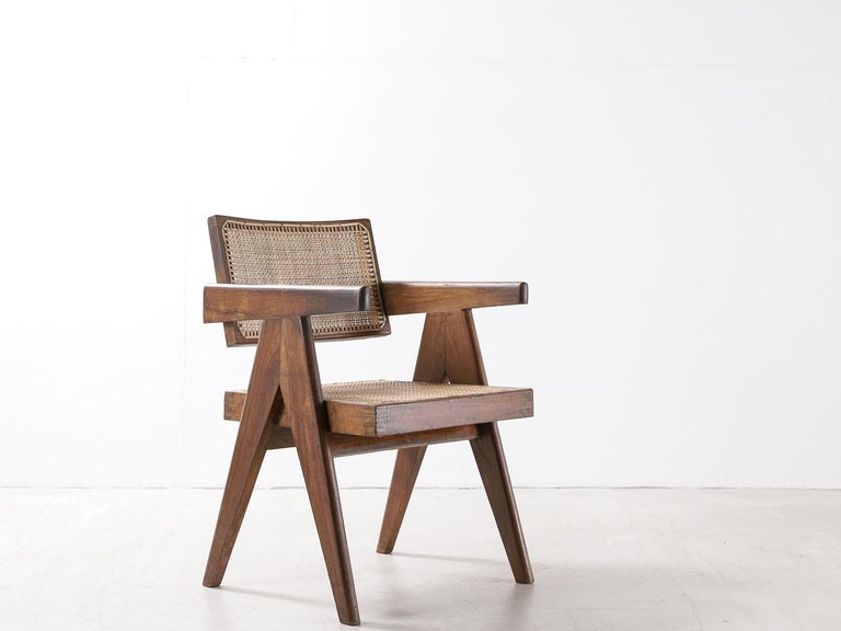 Set of 4 Pierre Jeanneret office chair Chandigarh, India: Model PJ-SI-28-A, 1950s. Designed for the architects office, secretariat, and administrative buildings, Chandigarh. Teak and rattan.  Photos include picture of chairs in original condition