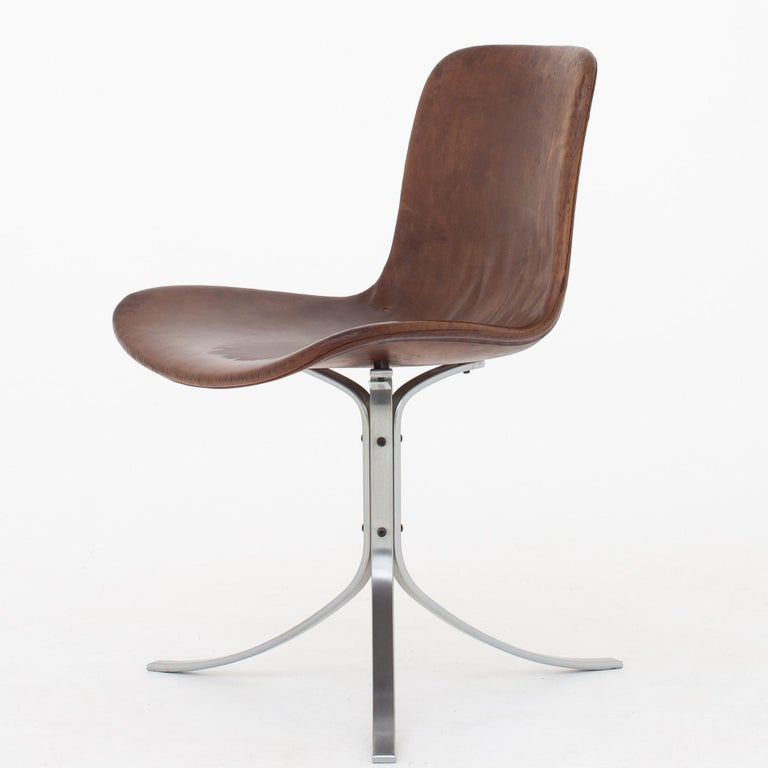 PK 9 - Set of four chairs in patinated, brown leather on chromed steel frame. Designed in 1960. Maker E. Kold Christensen.