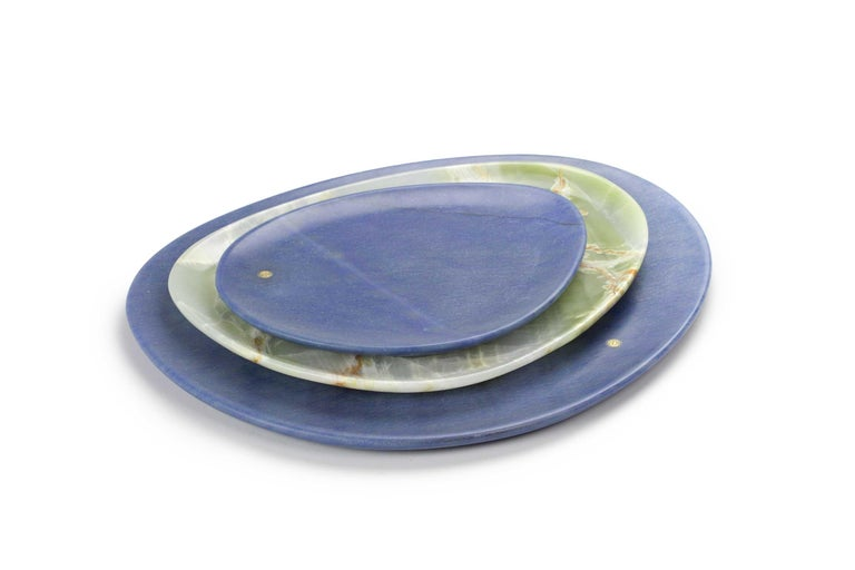 Hand carved presentation plates in extra blue Azul Macaubas and green onyx. Polished finishing. Multiple use as plates, platters and placers. Dimensions: Small - L24 W20 H1.8 cm, Medium - L30 W28 H1.8 cm, Big - L36 W35 H1.8 cm.  Pieruga proudly