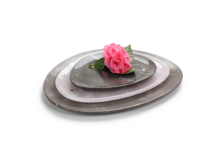 Hand carved presentation plates in Imperial grey marble and pink onyx. Multiple use as plates, platters and placers. Dimensions: Small - L 24 x W 20 x H 1.8 cm, Medium - L 30 x W 28 x H 1.8 cm, Big - L 36 x W 35 H 1.8 cm.  Pieruga proudly creates